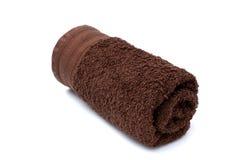 Asciugamano rotolato di Brown immagini stock