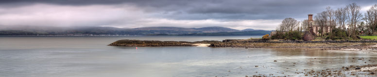 Ascog Bay. Panoramic Shot of Ascog Beach on the Scottish Isle of Bute on the firth of Clyde. Shot taken while the sun was setting. The tide was beginning to Stock Images