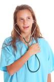 Ascoltando con lo stetoscopio Immagini Stock