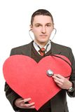 Ascoltando il cuore rosso Fotografia Stock Libera da Diritti