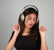 Ascoltando music-8 Immagini Stock