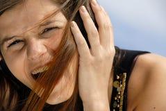 Ascolto della ragazza Fotografia Stock