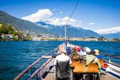Ascona, Switzerland – JUNE 24, 2015: Passengers enjoy the scenery of the Lake Maggiore Stock Photo