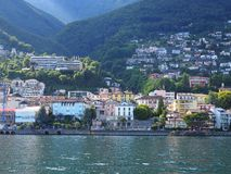 ASCONA travel city in SWITZERLAND with scenic view of beauty Lake Maggiore. At canton of Ticino and slope of alpine mountain range landscape at swiss Alps in Stock Photo