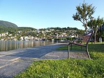ASCONA travel city in SWITZERLAND, view of park and beauty Lake Maggiore. At canton of Ticino, slope of alpine mountain range landscape at swiss Alps in 2017 Royalty Free Stock Photo