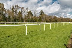 Ascot Horse Racecourse. Ascot, England - March 17, 2019: View of the iconic British Ascot racecourse heath, known for its horse racing royalty free stock image