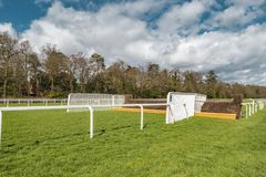 Ascot Horse Racecourse Heath Jump. Ascot, England - March 17, 2019: View of the iconic British Ascot racecourse heath, known for its horse racing royalty free stock photo
