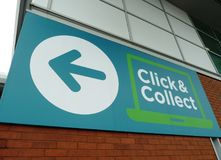 ASDA Click & Collect shopping sign. Blue green and white Asda Click & Collect sign for shopping bought online stock photography