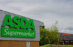 Asda and Sainsbury`s neighbouring supermarkets in Flint Royalty Free Stock Photos