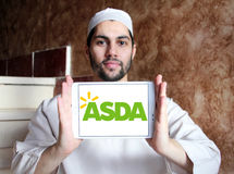 Asda stores logo. Logo of the international chain of convenience stores asda on samsung tablet holded by arab muslim man Royalty Free Stock Photography