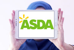 Asda stores logo. Logo of the international chain of convenience stores asda on samsung tablet holded by arab muslim woman Stock Image