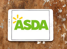 Asda stores logo. Logo of the international chain of convenience stores asda on samsung tablet on wooden background Royalty Free Stock Image