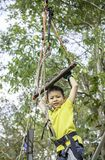 Asean boy hanging rod Tied with ropes and slings background blurry tree stock images