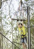 Asean boy hanging rod Tied with ropes and slings background blurry tree royalty free stock photo