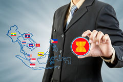 ASEAN Economic Community in businessman hand Stock Images