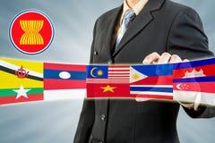 ASEAN Economic Community in businessman hand. ASEAN Economic Community or AEC in businessman hand Royalty Free Stock Photo