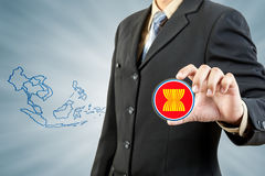 ASEAN Economic Community in businessman hand Royalty Free Stock Images