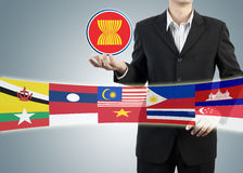ASEAN Economic Community in businessman hand Stock Image