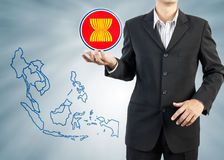 ASEAN Economic Community in businessman hand Stock Photography