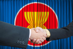 ASEAN Economic Community in businessman handshake Stock Photography