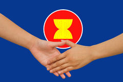 ASEAN Economic Community in businessman handshake Stock Images