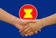 ASEAN Economic Community in businessman handshake. ASEAN Economic Community icon in businessman handshake Royalty Free Stock Image