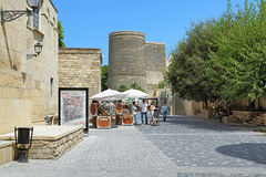 Asef Zeynalli Street and view of Maiden Tower in Baku, Azerbaija royalty free stock photos