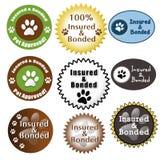 Asegurados del cuidado de animal doméstico y sellos consolidados Imagen de archivo libre de regalías
