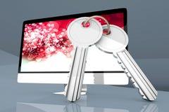 Asegure el ordenador con un par de llaves Foto de archivo