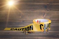 Asekuracyjny biznes, pieniężny sukces żółta ostrożności taśma na drewnianym tle Obraz Royalty Free