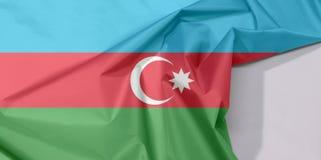 Aserbaidschan-Gewebeflaggenkrepp und -falte mit Leerraum stockfotografie