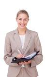 Asertoryczny bizneswoman robi notatkom na jej agendzie Fotografia Royalty Free