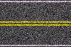 Asfalt - Gele en witte lijnen stock foto