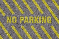 Asfalt - ingen parkering Arkivfoto