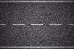 Asfalt - witte lijnen stock afbeelding
