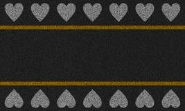 Asfaltachtergrond met geschilderde harten Royalty-vrije Stock Foto's