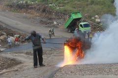 Asfaltbränning Fotografering för Bildbyråer