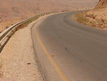 asfaltera ökenhuvudvägen Fotografering för Bildbyråer