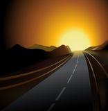 asfaltera för vägsunen för ljust kol den slags solnedgången brett Arkivbild