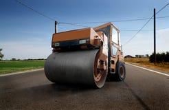 asfaltmaskinstenläggning Arkivfoton