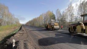 asfalto di riparazione della strada stock footage