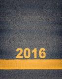 Asfaltowi Drogowi ocechowania Pokazuje 2016 Zdjęcia Royalty Free