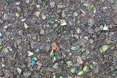 Asfaltowi włączenia barwioni kamienie zdjęcia royalty free