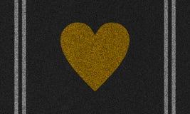 Asfaltowy tło z malującym sercem Zdjęcia Royalty Free