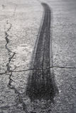 asfaltsammanbrottgummihjul Arkivbilder
