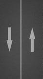 Asfalttextur med pilar Arkivbilder