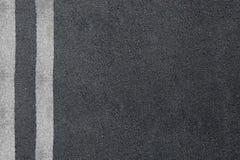 Asfaltväg med avskiljandelinjer Huvudvägtextur Fotografering för Bildbyråer