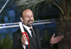 Asghar Farhadi poses with his award for the Best Screenplay. For the film `The Salesman Forushande` at the Photocall during the 69th Cannes Festival at the Stock Photo