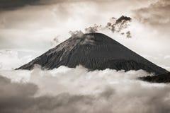 Ash cloud rising at Semeru Volcano Mountain, East Java, Indonesi Stock Photos