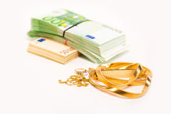 Ash for gold jewelry lays next to a pile of euro banknotes cash Royalty Free Stock Photos